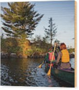 A Young Couple Paddles A Canoe On Long Wood Print