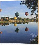 Balloons Heading East Wood Print by Carol Groenen