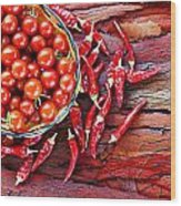 Basket Of Ripe Cherry Tomatoes And Dried Red Chillies On Rustic  Wood Print
