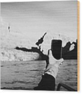 man taking photos with smartphone during boat ride along the colorado river in the grand canyon Ariz Wood Print