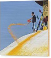 Man Throwing Orange Paint On Boudhanath Stupa Wood Print