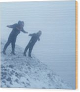 2 Men Leaning Against The Freezing Wind Wood Print