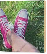 Pink Sneakers On Girl Legs On Grass Wood Print