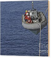 Sailors Lower A Rigid-hull Inflatable Wood Print