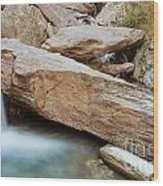 Small Waterfall Casdcading Over Rocks In Blue Pond Wood Print