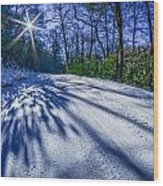 Snow Covered Road Leads Through The Wooded Forest Wood Print