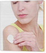 Woman Using A Transdermal Drug Patch Wood Print