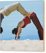 A Man And Woman Practicing Yoga Wood Print