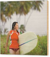 A Woman Carries A Surfboard To The Beach Wood Print