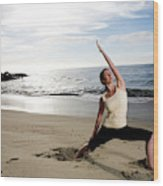 A Women At The Beach Performing Yoga Wood Print
