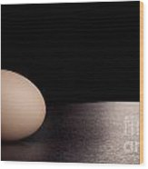 Egg On Black Wood Print