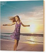 Girl Jumping And Dancing On Beautiful Beach. Wood Print