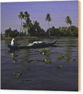 Man Boating On A Salt Water Lagoon Wood Print