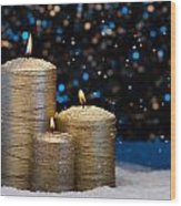 Three Gold Candles In Snow  Wood Print