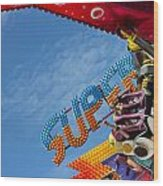 Colorful Fairground Ride Wood Print by Ken Biggs