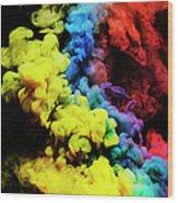 Coloured Smoke Mixing In Dark Room Wood Print