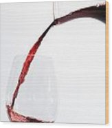 Red Wine Pouring Into A Glass Wood Print