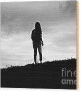 Silhouette Of Girl Against Overcast Sky Wood Print