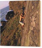 A Man Is Bouldering Near The Ocean Wood Print