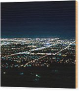 Aerial View Of A City Lit Up At Night Wood Print