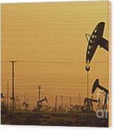 California Oil Field Under Amber Sky Wood Print