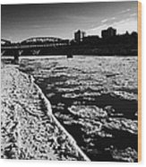 large chunks of floating ice on the south saskatchewan river in winter flowing through downtown Sask Wood Print