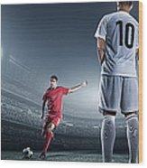 Soccer Player Kicking Ball In Stadium Wood Print