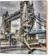 Tower Bridge And The Girl And Dolphin Statue Wood Print