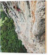 A Athletic Man Rock Climbing High Wood Print