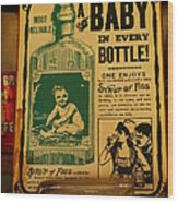 A Baby In Every Bottle Wood Print