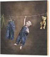 A Baby On The Clothesline Wood Print