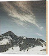 A Backpacker Gazes Up At Needle Peak Wood Print