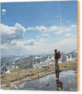 A Backpacker Stands Atop A Mountain Wood Print