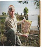 A Bee Keeper Checks On The Health Wood Print
