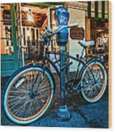 A Bike In Front Of Cafe Du Monde In New Orleans Wood Print