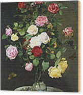 A Bouquet Of Roses In A Glass Vase By Wild Flowers On A Marble Table Wood Print