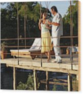 A Couple Having Drinks On A Deck Wood Print