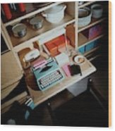 A Cupboard With A Blue Typewriter Wood Print