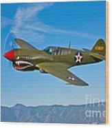 A Curtiss P-40e Warhawk In Flight Wood Print