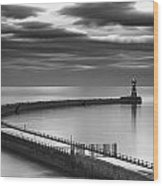 A Curving Pier With A Lighthouse At The Wood Print