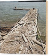 A Dock Covered With Driftwood Wood Print