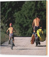 A Father And Son Ride Their Bikes To Go Wood Print