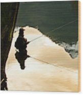 A Fly Fisherman Standing In A River Wood Print
