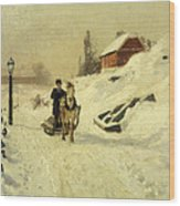 A Horse Drawn Sleigh In A Winter Landscape Wood Print by Fritz Thaulow