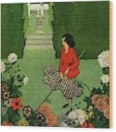 A House And Garden Cover Of A Woman Raking Leaves Wood Print
