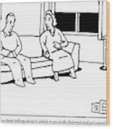 A Husband And Wife Sit On The Sofa Wood Print