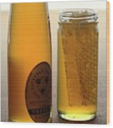 A Jar And Bottle Of Honey Wood Print