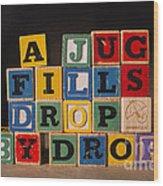 A Jug Fills Drop By Drop Wood Print