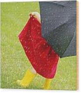 A Little Girl Walking In The Rain While Wood Print