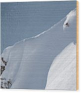 A Lone Skier Descends A Steep Line Wood Print